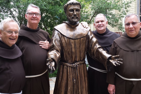 ABVM Friars with a welcoming statue of Francis at Sacred Heart Church in McAllen, Texas